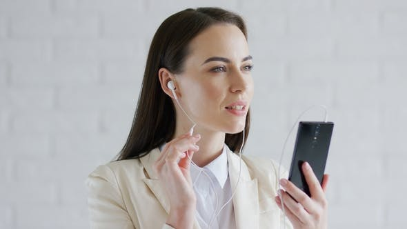 Thumbnail for Businesswoman Listening To Music