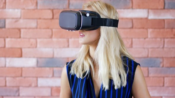 Young Woman in VR Goggles