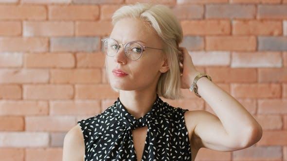 Thumbnail for Elegant Woman Scratching Head