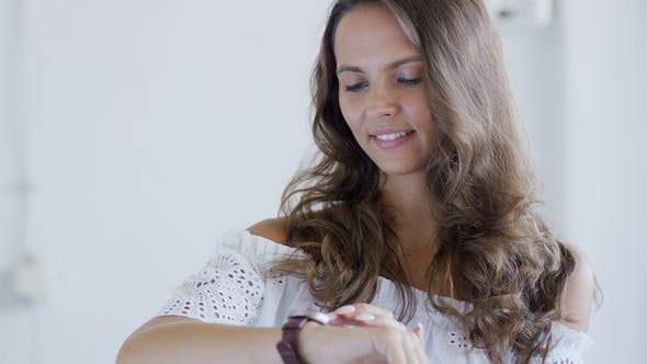 Thumbnail for Woman with Wavy Hair Checking Time