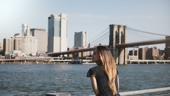 Thumbnail for Panning View of Happy Smiling European Woman with Flying Hair Enjoying Famous New York Skyline and