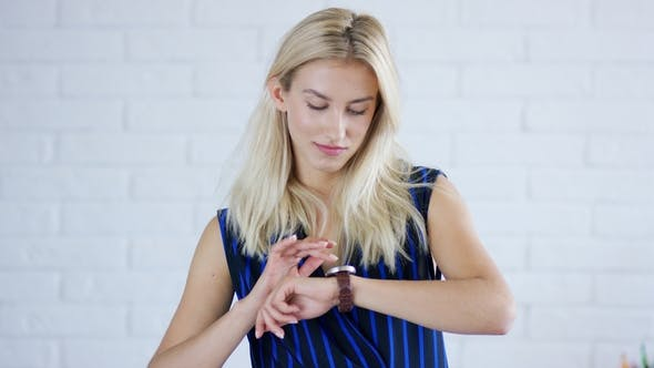 Thumbnail for Young Female Looking at Wristwatch