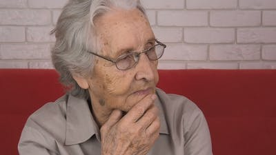 An Elderly Woman Thinks Sad Thoughts.