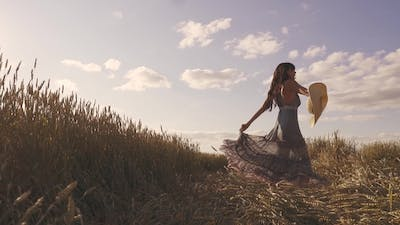 Happiness and Joy Young Woman Who Turns on a Wheat Field Smiling
