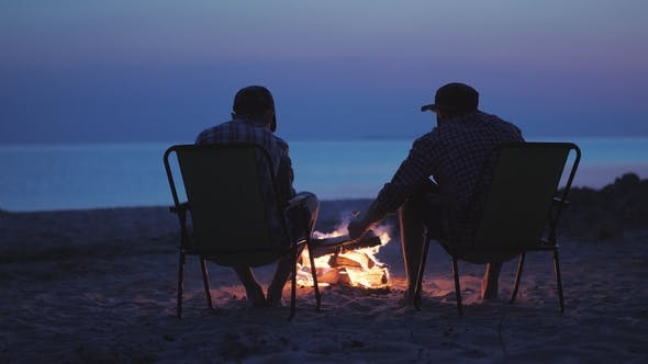 Cover Image for Two Friends Are Frying Marshmallows Around the Fire
