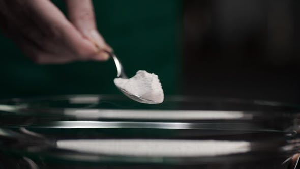 Thumbnail for Chef Adds Soda To the Cooked Meal in , Spoon and Flour, Spices To the Meal, Cooking at the Kitchen