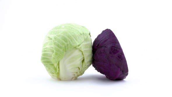 Thumbnail for One Whole Mini White Cabbage and One Half or Red Cabbage. Rotating on the Turntable Isolated on the