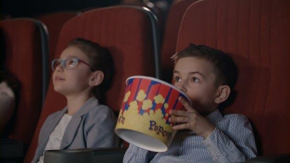 Children Watching Movies in Cinema. Movie Entertainment for Kids