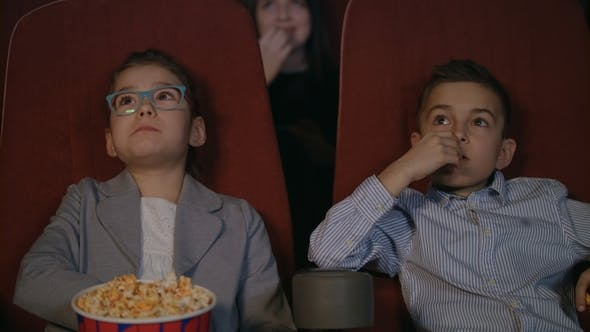 Thumbnail for Young Spectators Watching Movie at Cinema. Movie Children Entertainment