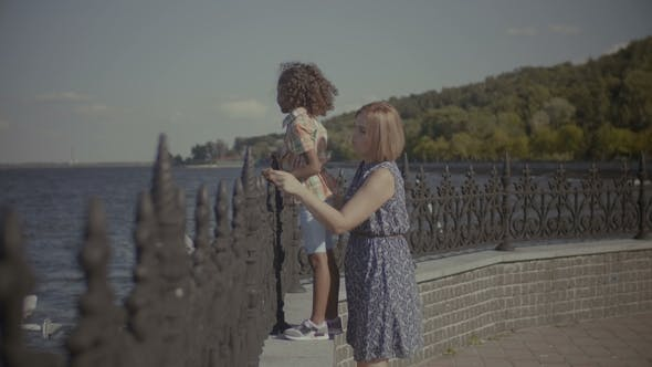 Thumbnail for Mother with Cute Little Girl Enjoying View at Sea