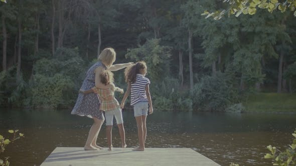 Thumbnail for Diverse Family Standing on Wooden Jetty By Lake