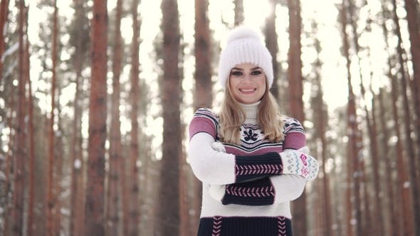 Thumbnail for Portrait of a Girl with a Charming Smile in a Knitted Sweater in a Winter Forest