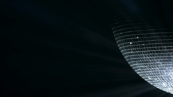 Thumbnail for Mirror Ball, Also Known As a Disco Ball, Spinning Against Black