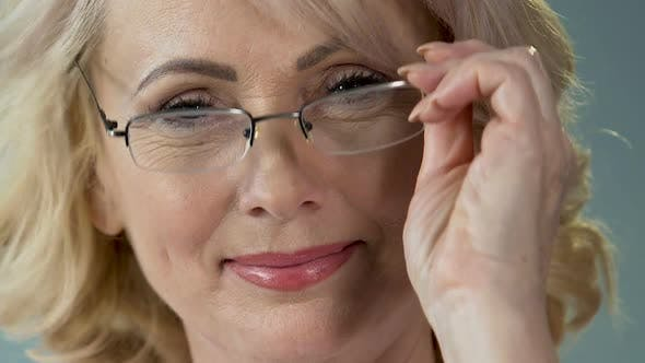 Thumbnail for Good-Looking Mature Woman Wearing Eyeglasses and Smiling, Ophthalmology