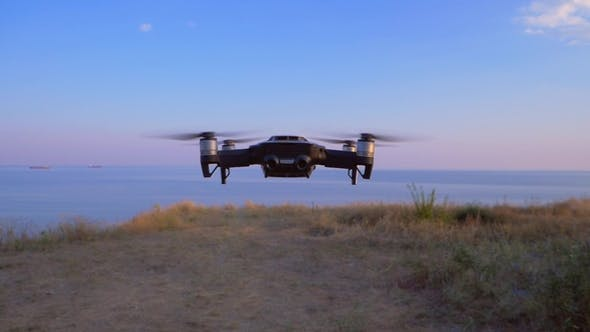 Thumbnail for Quadrocopter Flies in Place Against the Background of the Sea UAV in