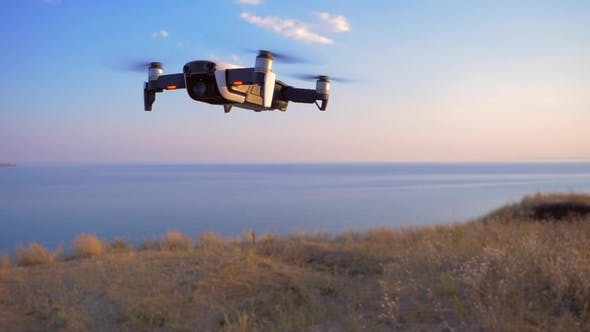 Thumbnail for Quadrocopter Flies in Place Against the Background of the Sea