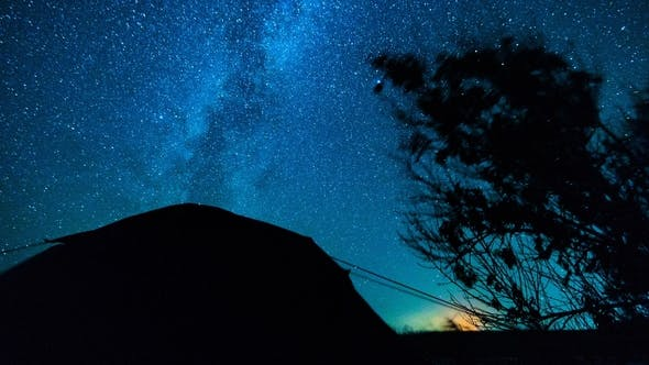 Thumbnail for Stars . Camping Under the Stars.  Stars Moving Over Trees and Tent
