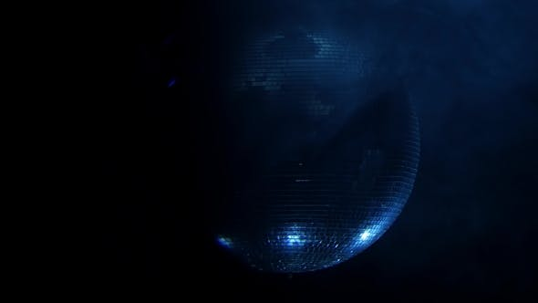 Thumbnail for Shiny Disco Ball Rotating Around on Smoke Black Background