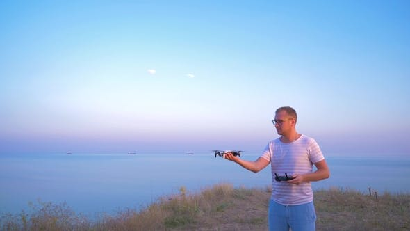 Thumbnail for Quadrocopter Takes Off From the Hands of Men. Shooting in