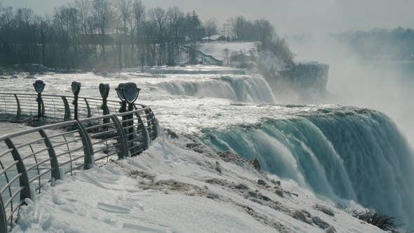 Thumbnail for Winter at Niagara Falls. Sight Place with Binoculars Without People