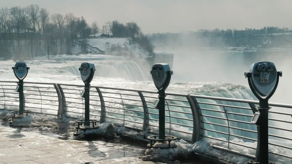 Thumbnail for Niagara Falls Without Tourists in the Winter Season. A Row of Binoculars, No One Is Near