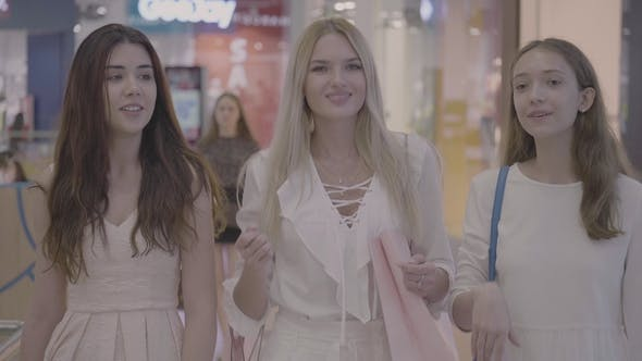 Thumbnail for Girls Friends Walk and Talking in Shopping Mall