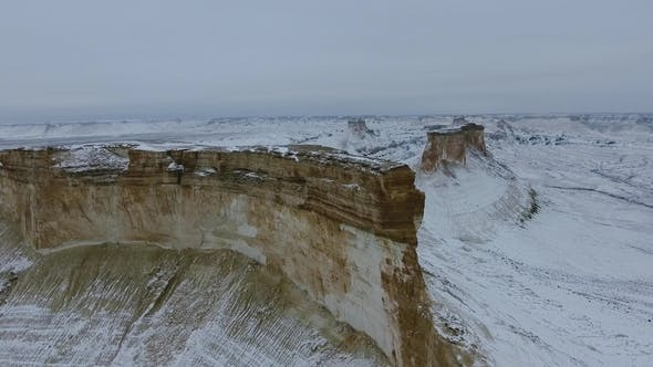 Thumbnail for Amazing Aerial View of Snow-covering Ustyurt Sandy Mountains in Western Kazakhstan, Mangyshlak