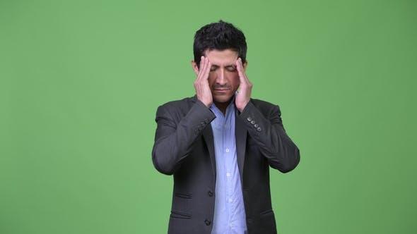 Thumbnail for Stressed Hispanic Businessman Having Headache