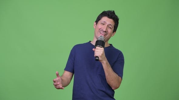 Thumbnail for Hispanic Man Singing on the Microphone