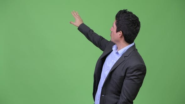 Thumbnail for Hispanic Businessman Presenting Something