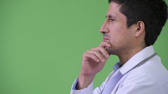 Thumbnail for Profile View of Hispanic Man Doctor Thinking