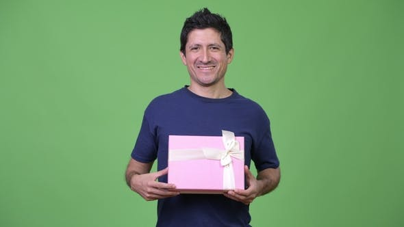 Thumbnail for Happy Hispanic Man with Gift Box