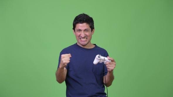 Thumbnail for Hispanic Man Playing Games and Winning