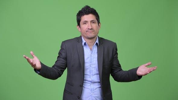 Thumbnail for Hispanic Businessman Shrugging Shoulders