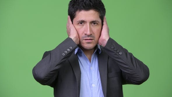 Thumbnail for Hispanic Businessman Covering Ears As Three Wise Monkeys Concept