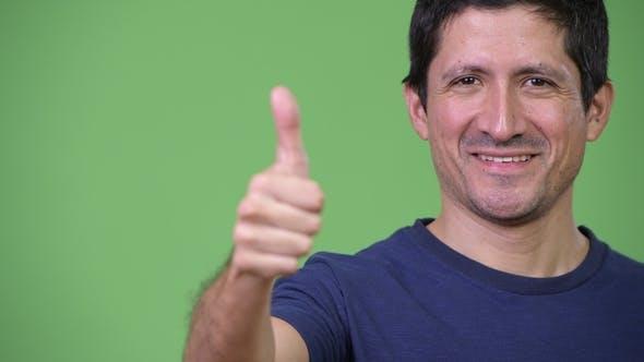 Thumbnail for of Happy Hispanic Man Giving Thumbs Up
