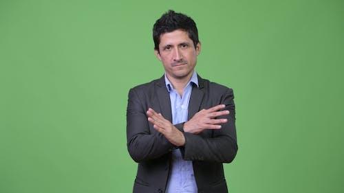 Hispanic Businessman with Stop Gesture