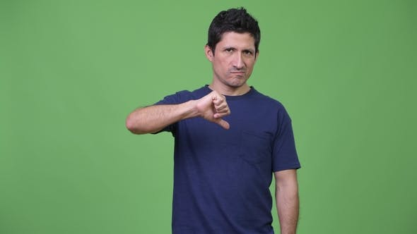 Upset Hispanic Man Giving Thumbs Down