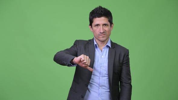 Thumbnail for Stressed Hispanic Businessman Giving Thumbs Down