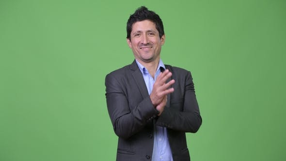 Thumbnail for Happy Hispanic Businessman Clapping Hands
