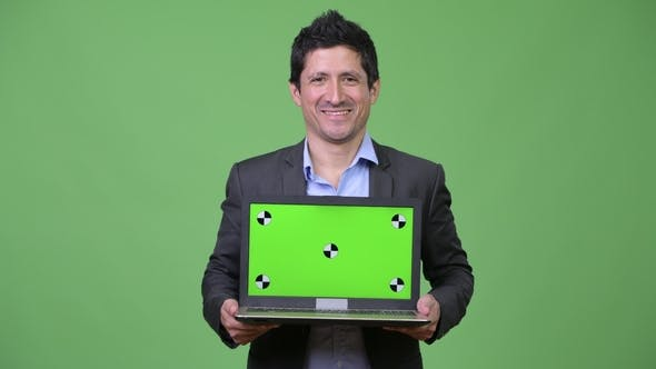Thumbnail for Happy Hispanic Businessman Showing Laptop