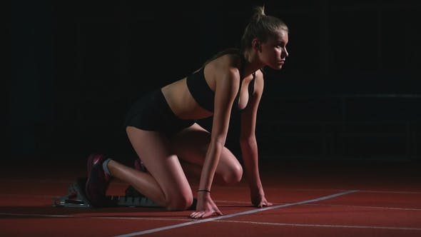 Cover Image for Professional Woman Athlete on a Dark Background