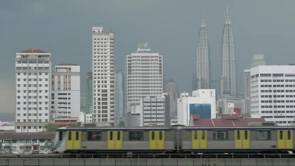 Thumbnail for View of Train on the Foreground and Modern Buildings Skyscraper on the Background. Kuala Lumpur