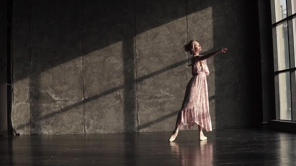Thumbnail for Graceful and Elegant Ballerina Dancing in Pointe Shoes on a Dark