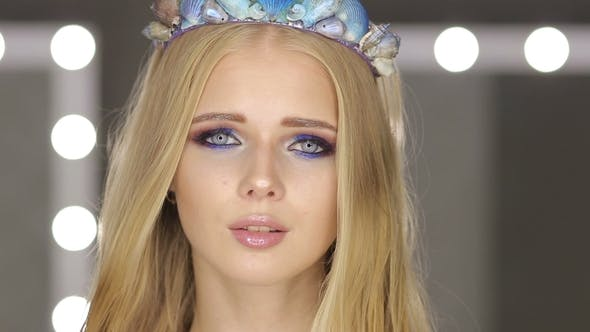 Thumbnail for Woman with Blond Hair and Blue Eyes in Room with Mirrors