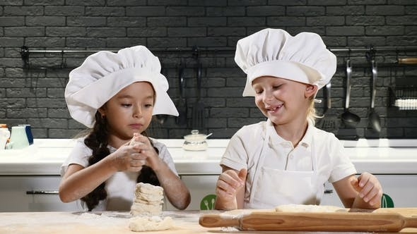 Thumbnail for Funny Cooking. Children Cook Cake Together, Rolling Dough and Playing