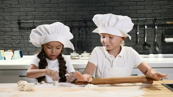 Thumbnail for Chef Kid. Two Kids Play Kitchen. Little Boy and Preschool Boy in Chef Hats and Aprons Roll Dough