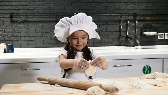 Thumbnail for Little Pretty Girl in Chef Hat and Apron. Kid Chef Concept. Adorable Girl Playing with Dough
