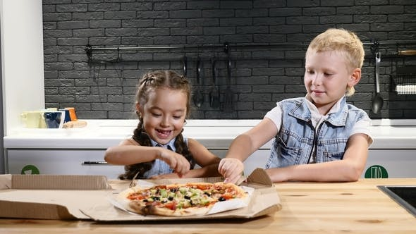 Two Children Eating Pizza Trying First Piece