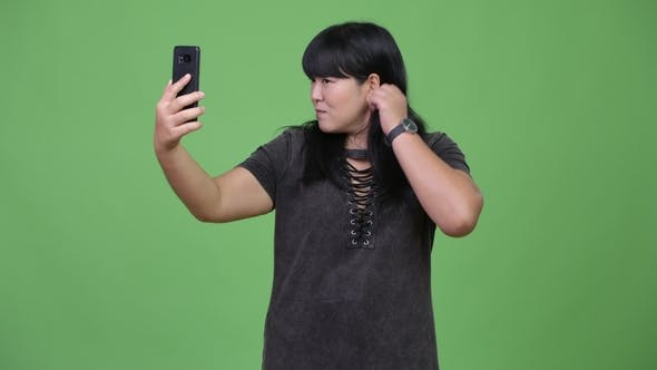 Thumbnail for Beautiful Overweight Asian Woman Taking Selfie